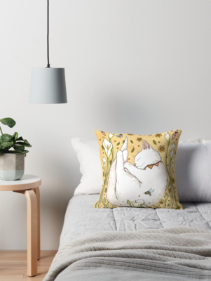 Butterflies, bees and cat on a throw pillow