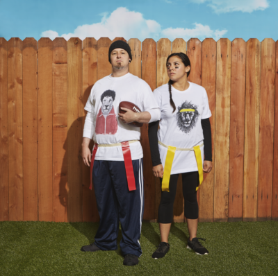 two people on opposite teams playing flag football