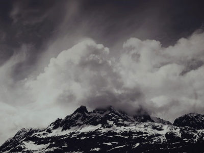 snowy mountains black white with clouds
