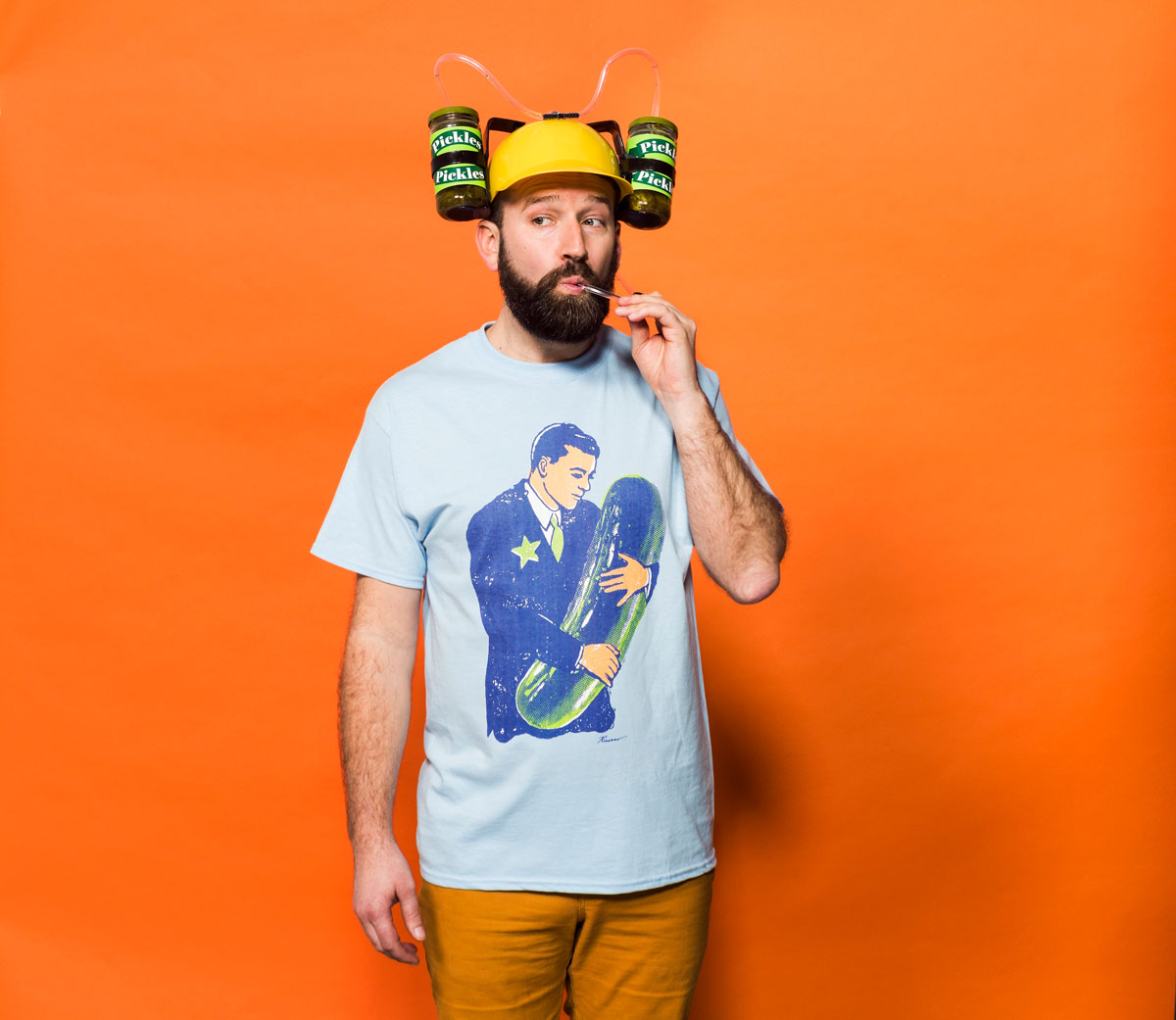 man drinking beer from hat with straws