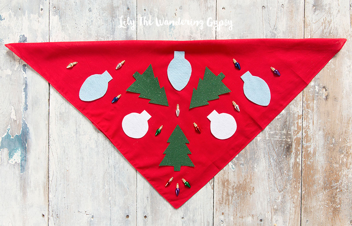 red bandana with xmas lights and green fir trees