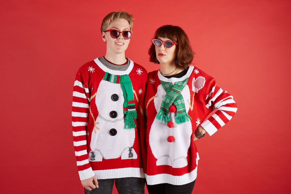 boy and woman wearing a double snowman sweater