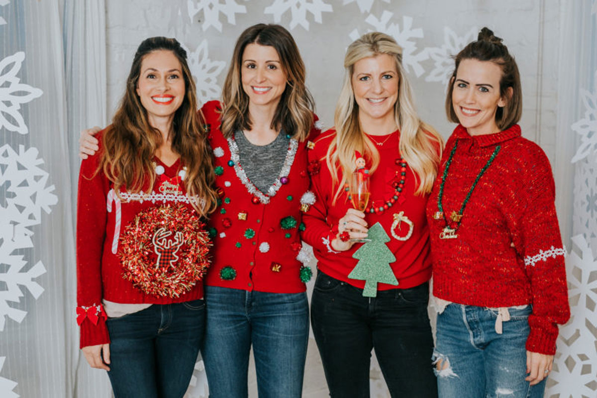 four ladies wearing ugly red holiday sweater