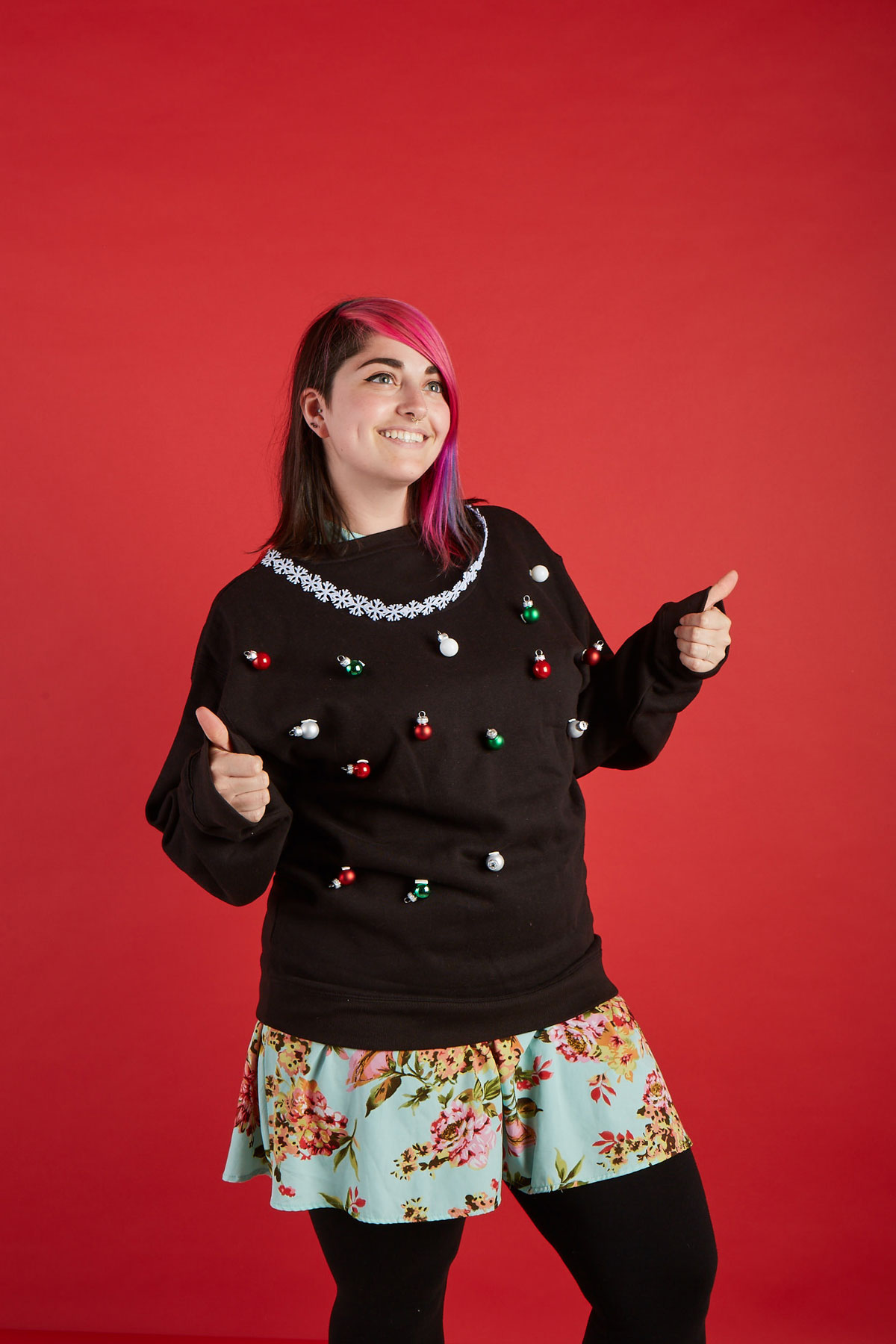 woman wearing xmas sweaters with tiny ornaments
