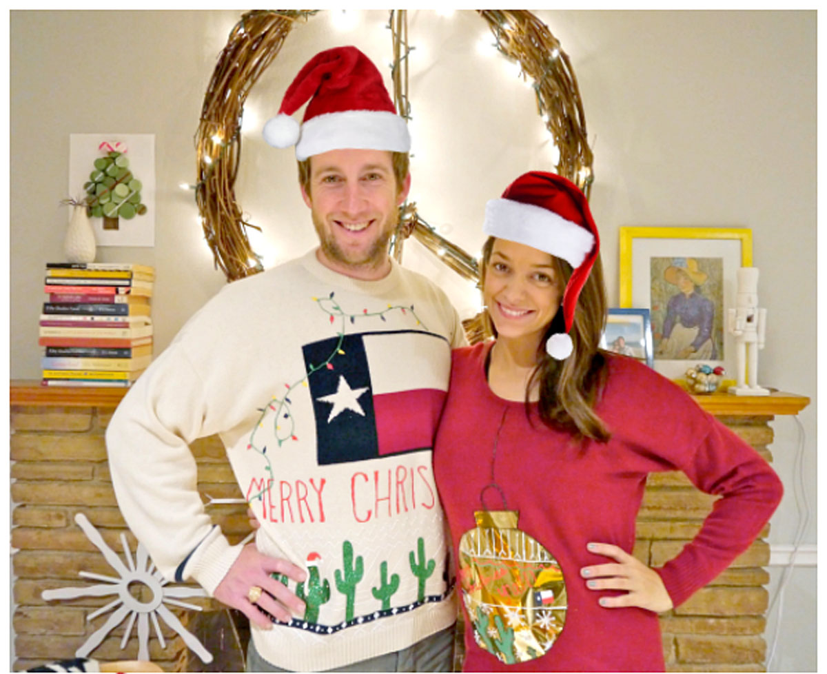 man wearing texas christmas sweater in santa hat with woman wearing a red ornament sweater
