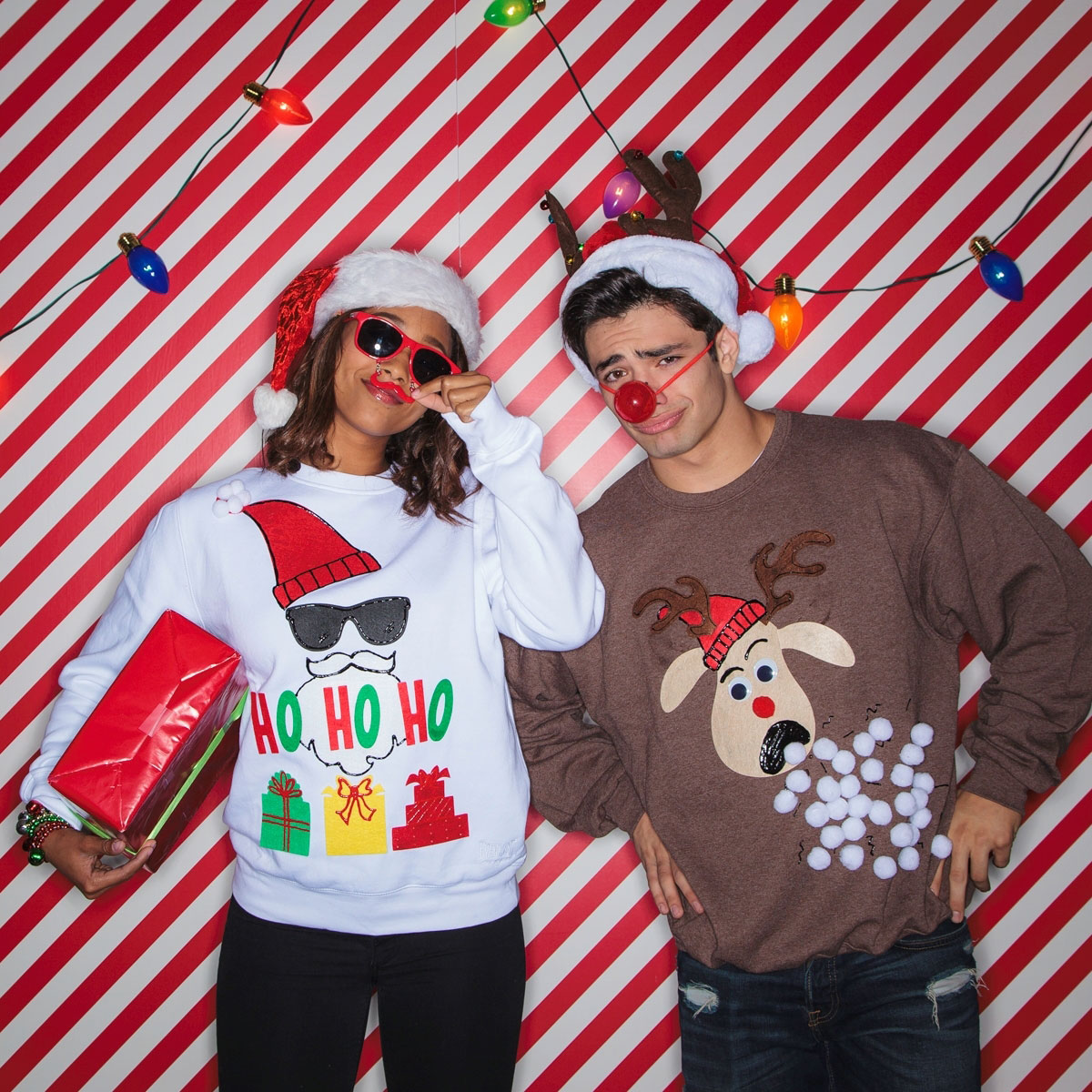 Man and woman couple wearing xmas sweater wearing a red rudolph noes and glasses with mustache