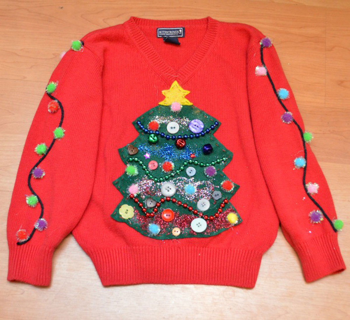 red xmas sweater with ornaments as buttons