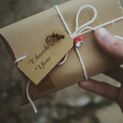 Photo of a Brown paper wrapping with gardening twine and a tag