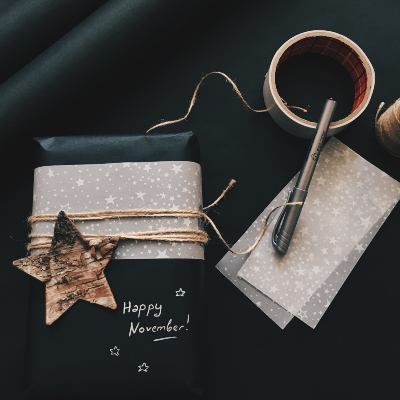 Photo of Gift wrapping with black paper and accent paper