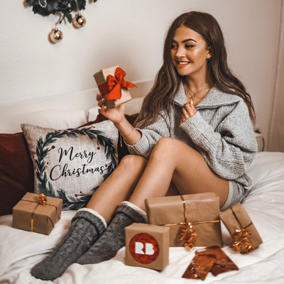 Photo of a girl with Gifts in brown wrapping paper