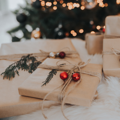 Photo of Gifts wrapped with brown wrapping papers and ornaments