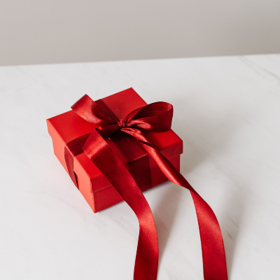 Photo of a Red gift box with red ribbon