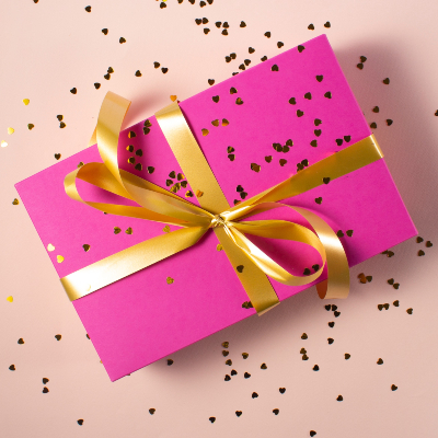 Photo of a Wrapped gift adding glitter sparingly