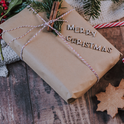 photo of brown paper gift wrapping with wooden letters