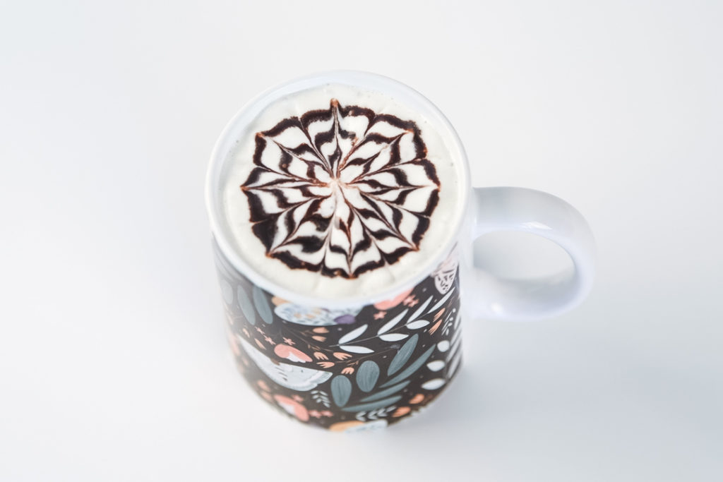 image of a flower syrup design on a cup of coffee