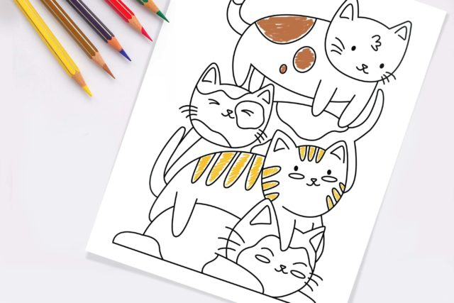 photo of a kawaii cat coloring page on a table