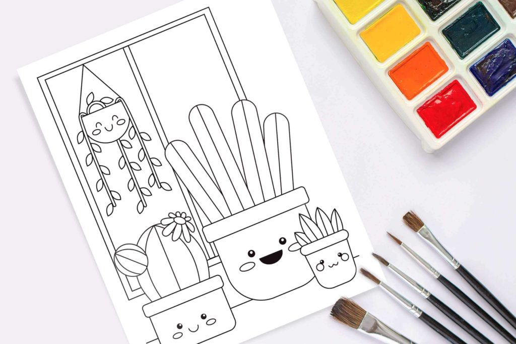 photo of kawaii plant coloring page on table with watercolor set