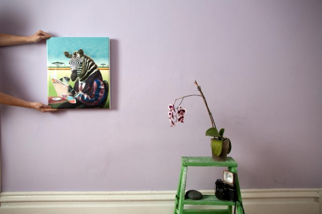 Photo of a canvas hanging on a wall