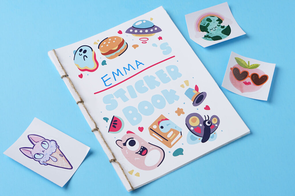 photo of stickers next to a sticker book