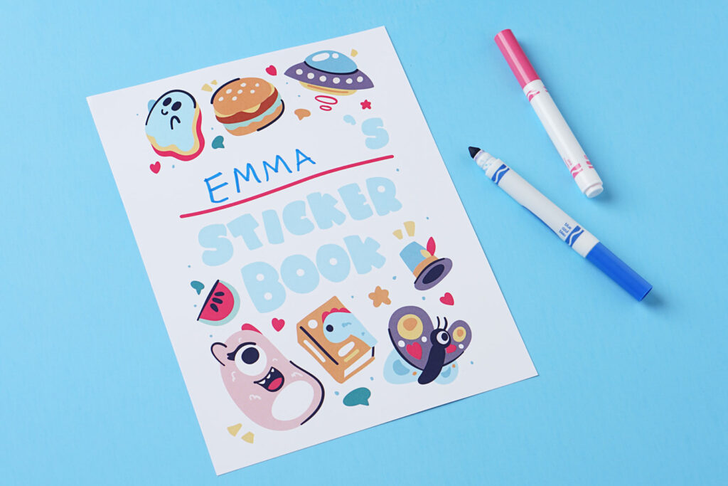 photo of the cover of a sticker book being personalized with colored markers