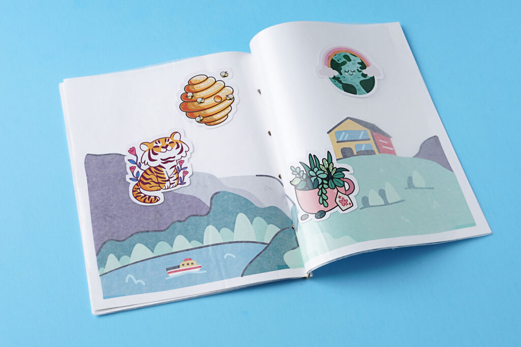 photo of the sticker book with an exciting scene