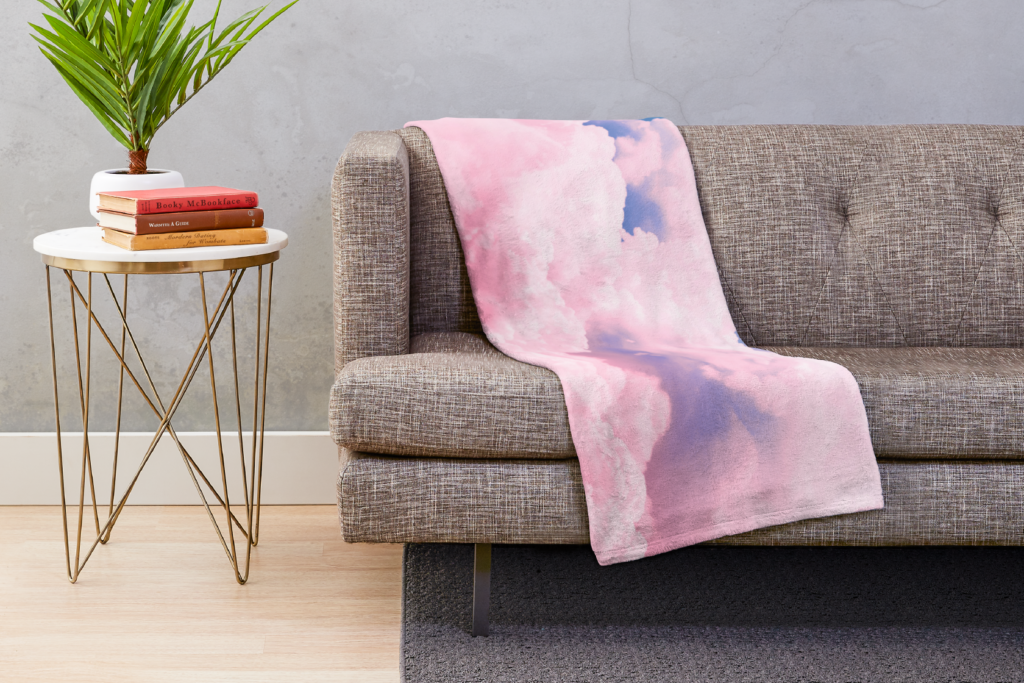 photo of a throw blanket with clouds on a couch