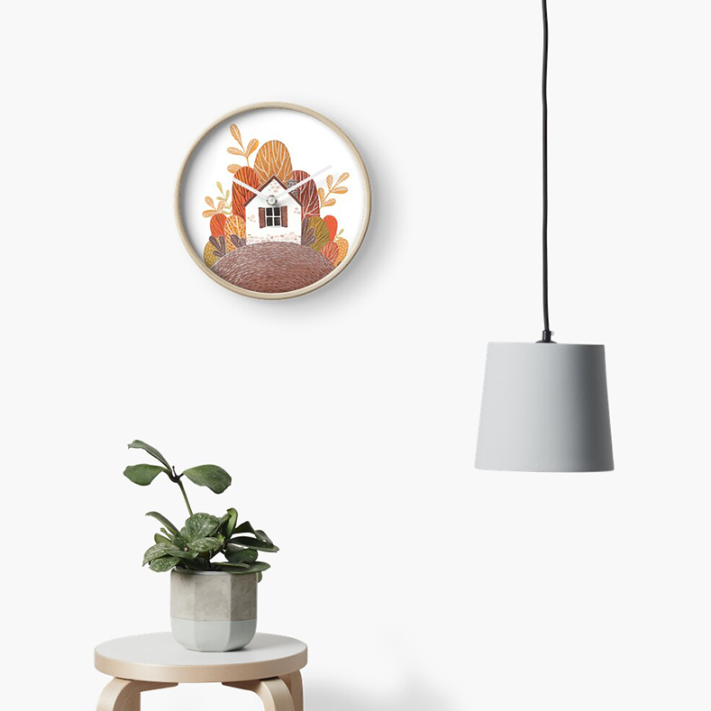 fall themed clock hanging on a wall